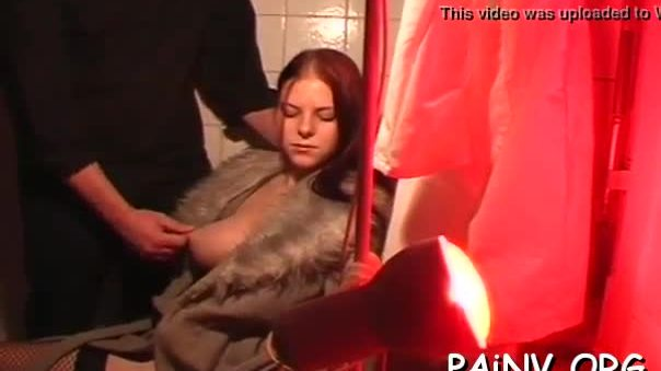 Bondage act with a man who gets tortured by domina