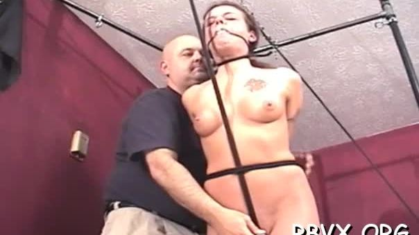 Naked slut gets aroused while being tied to the sofa